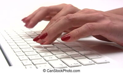Female hands typing on a white computer keyboard. Canon HV30. HD 16:9 1920 x 1080 @ 25.00 fps. Progressive scan. Photo JPG Compression. No audio.