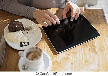 typing on blank screen tablet breakfast