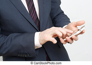 Typing on cell phone - A business man typing on cell phone