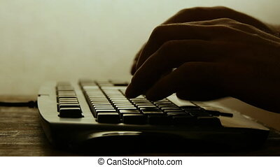 Typing on computer keyboard silhouette