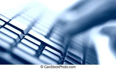 typing on keyboard closeup view