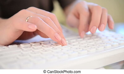 Typing on keyboard. Woman hands, close view
