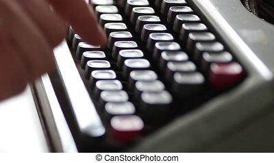 Typing on old vintage typewriter machine