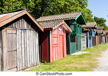 typique colored wooden houses in biganos port in the Bay of Arcachon