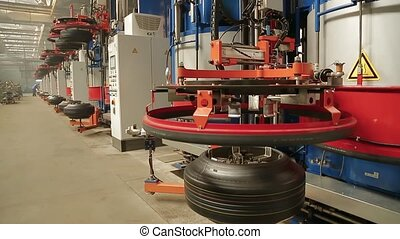 Tyre production machine at tyres factory - Automated machine...