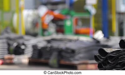 Tyre production machine. - Rubber processing at an...