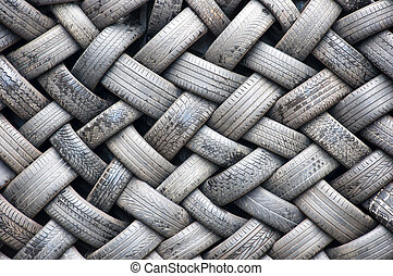 Tyre wall - A background abstract image of a wall made...