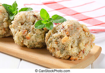 Round bread-and-flour dumplings made with herbs and smoked bacon