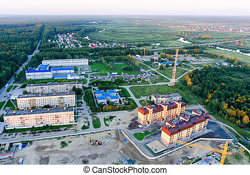 Vinzili, Russia - August 1, 2015: Aerial view onto Tyumen oil pipeline professional lyceum and residential district at sunset