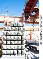 Crane operator works at finished good warehouse