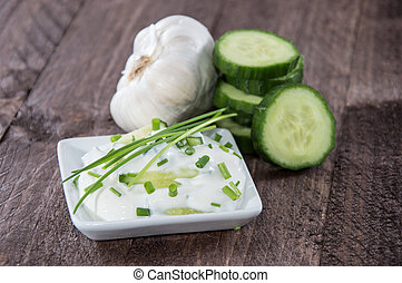 Tzatziki with ingredients in a bowl - Tzatziki with...