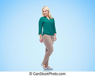 uśmiechanie się, młoda kobieta, w, koszula, i, spodnie