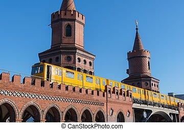 U-Bahn train crossing the Oberbaum Bridge in Berlin Germany
