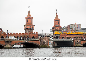 U-Bahn train passing over Oberbaum Bridge in Berlin, Germany...
