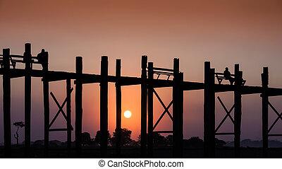 U Bein bridge at sunset in Amarapura, Myanmar