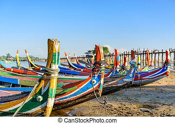 U Bein Bridge Boats - Mandalay, Myanmar boats on the...