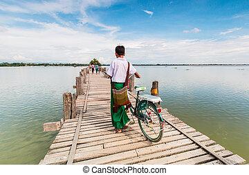 U Bein Bridge, Myanmar-Aug 26th, 2014: Myanmar was walking...
