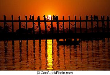 U-Bein Bridge. Myanmar - famous tick U-Bein bridge at sunset...