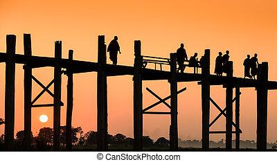 U Bein bridge, Myanmar - U Bein wooden bridge at sunset in...