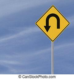 U-Turn Road Sign - U-turn road sign on a blue sky background...