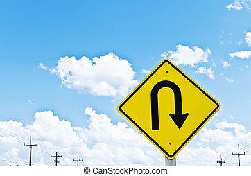 u-turn symbol and a beautiful blue sky