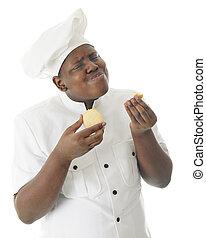 U-umm Good! - A young chef taste testing his sugar cookies. ...