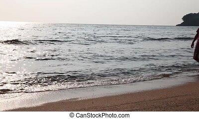%u0421ouple on beach.