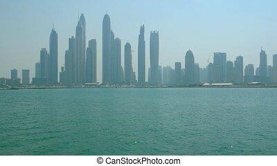UAE Skyline - skyscrapers on the sea coast. 4k UltraHD video