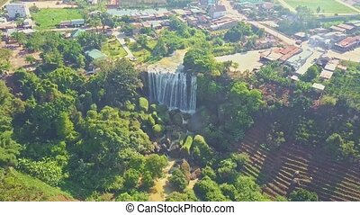 UAV Flies above and to Giant Waterfall by Tropical Park - ...