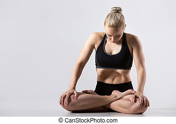 Uddiyana Bandha practice - Portrait of sporty beautiful...