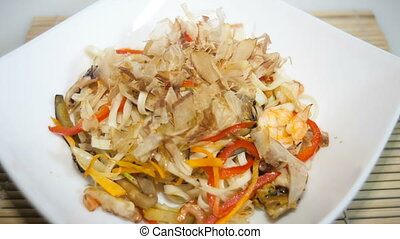udon noodles with sea food and tuna moving chips