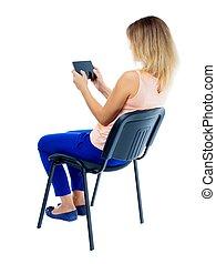 udsigt tilbage, i, kvinde sidde stol