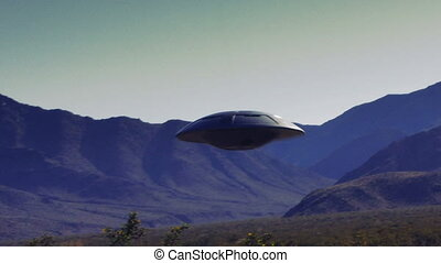 UFO 003: Stock retro footage of a UFO flying saucer in the desert.