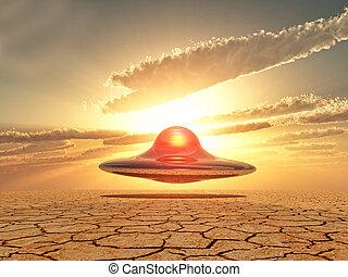 ufo landing - ufo flying over the desert on sunset...