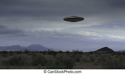 UFO 008: A flying saucer hovers over a windy desert.