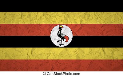 Uganda flag with the effect of crumpled paper and grunge