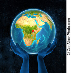 Uganda on Earth in hands