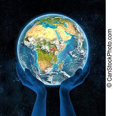 Uganda on planet Earth in hands