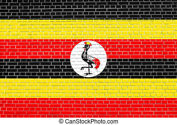 Flag of Uganda on brick wall texture background