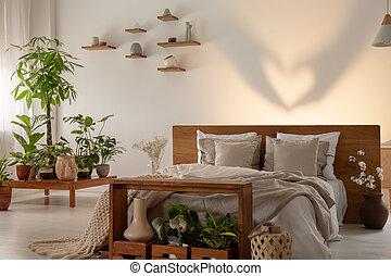 uggia, su, parete, dietro, letto, con, legno, testata letto, in, camera letto, interno, con, plants., reale, foto