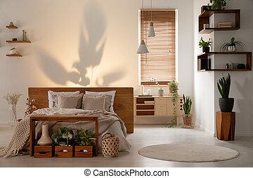 uggia, su, parete, sopra, uno, letto, in, uno, moderno, camera letto, interno, con, legno, mensole, scatole, e, plants., reale, foto
