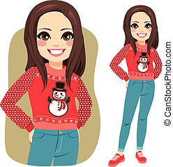 Beautiful brunette young woman with ugly Christmas sweater standing