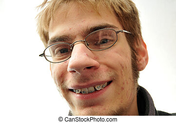Ugly nerd smiling - Young man trying to smile with braces...