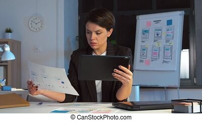 ui designer with tablet pc working at night office -...
