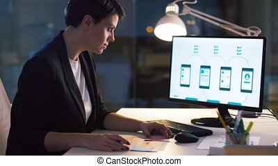ui designer working on interface at night office - business,...