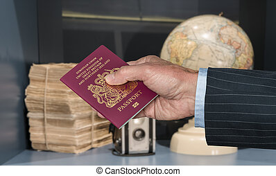 UK Citizen with passport and world globe with camera