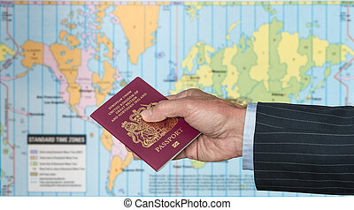 UK Citizen with passport and world map of timezones