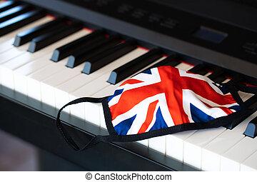 UK flag fabric mask on piano keyboard. Closeup