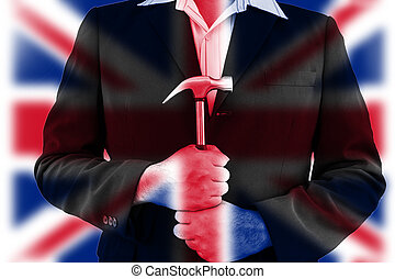 uk flag on business man hold hammer with his hand