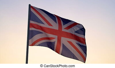 UK flag waving over sunset sky. - UK Great Britain national ...